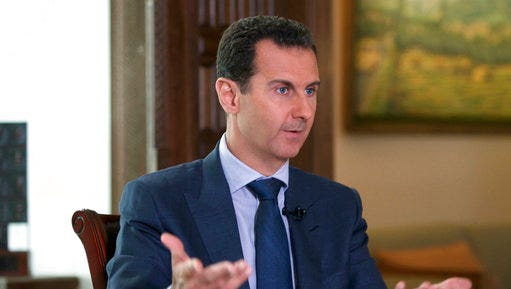 """FILE -- In this Sept. 21, 2016 file photo released by the Syrian Presidency, Syrian President Bashar Assad speaks to The Associated Press at the presidential palace in Damascus, Syria. U.S. Secretary of State Rex Tillerson's statement Tuesday, April 11, 2017, that the reign of President Bashar Assad's family """"is coming to an end"""" suggests Washington is taking a much more aggressive approach about the Syrian leader. Taking him out of the equation without a clear transition plan would be a major gamble."""