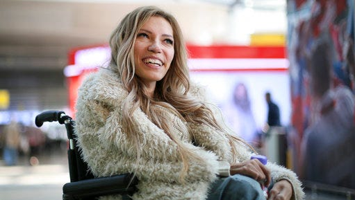 FILE - In this file photo dated Tuesday, March 14, 2017, Russian singer Yulia Samoylova who was chosen to represent Russia in the 2017 Eurovision Song Contest, poses while sitting in a wheelchair at Sheremetyevo airport outside Moscow, Russia.   Russia's Channel One says it will not broadcast the Eurovision Song Contest in Russia after Ukraine, which hosts the contest this year, has barred the Russian entrant from traveling to the country.