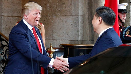 FILE - In this Thursday, April 6, 2017, file photo, President Donald Trump shakes hands with Chinese President Xi Jinping as he arrives before dinner at Mar-a-Lago resort, in Palm Beach, Fla. In recent weeks, Trump has moved away from his tough campaign rhetoric on trade. Trump's threat to slap harsh tariffs on Chinese goods has given way to a bid to mend fences with Beijing.