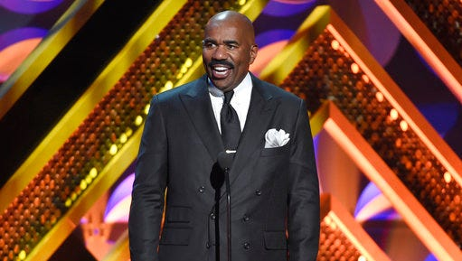 "FILE - In this April 26, 2015 file photo, Steve Harvey presents an award at the 42nd annual Daytime Emmy Awards in Burbank, Calif. The Fox network says it has picked up ""Showtime at the Apollo"" as a one-hour weekly series set to debut next season. Harvey will serve as host."