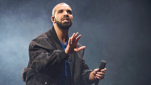 FILE - In this Oct. 8, 2016 file photo, Drake performs onstage in Toronto. Authorities say an intruder was arrested at Drake's Southern California house, but the woman apparently did nothing but drink the rapper's water and soda pop. The Los Angeles County Sheriff's Department says deputies from its Malibu/Lost Hills Station arrested 24-year-old Mesha Collins Monday, April 17, 2017, inside the home of Drake, whose real name is Aubrey Graham.