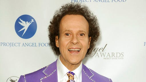 "FILE - In this Aug. 10, 2013 file photo, fitness guru Richard Simmons arrives at the Project Angel Food's 2013 Angel Awards in Los Angeles. After an absence from the spotlight, Richard Simmons is speaking out directly to his fans, saying, ""Hope to see you again soon!"" Simmons issued a statement to People magazine Wednesday. After reportedly being hospitalized Monday for severe indigestion, Simmons sent greetings Wednesday to ""everyone who has shown concern for me and sent their good wishes."" He also says that ""by now you know that I'm not 'missing,' just a little under the weather. I'm sure I will be feeling good and back home in a couple of days."""