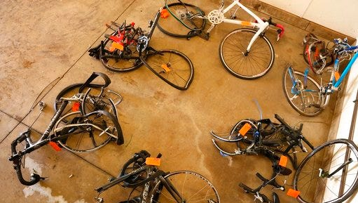 Charles Pickett was arrested and charged after he drove his pickup truck into a line of nine bicyclists riding in Cooper Township near Kalamazoo on June 7, 2016. The mangled bicycles are tagged as evidence at the Michigan State Police crime lab in Kalamazoo.