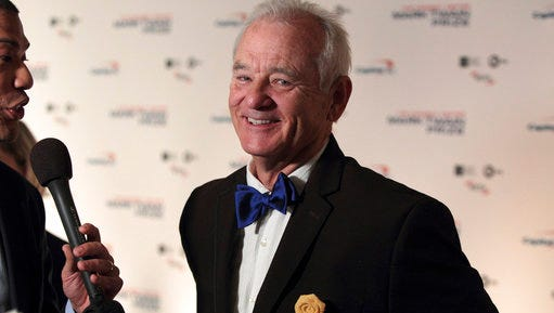 FILE - In this Oct. 23, 2016, file photo, Bill Murray arrives at the Kennedy Center for the Performing Arts for the 19th Annual Mark Twain Prize for American Humor presented to Bill Murray in Washington. The New York Times reported on April 19, 2017, that Murray is set to go on tour with a chamber music trio for a program of songs and literary readings.
