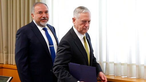 Israeli Defense Minister Avigdor Lieberman, left, and U.S. Defense Secretary Jim Mattis takes seats for a meeting at the Defense Ministry in Tel Aviv, Israel, Friday, April 21, 2017.