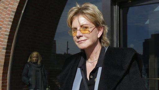 FILE - In a Feb. 7, 2013, file photo, author Patricia Cornwell leaves federal court in Boston after she took the stand in her lawsuit against her former financial management company. Media outlets report that Cornwell visited the department Monday, April 24, 2017, and paid the costs for an entire weeklong course on gunshot restoration, worth an estimated $20,000. The purpose of the donation is philanthropic, but Cornwell said she also intends to observe the course as part of research for her next novel.