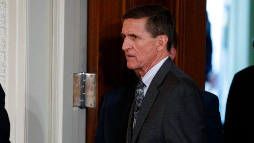 FILE - In this Feb. 13, 2017 file photo, Mike Flynn arrives for a news conference in the East Room of the White House in Washington. An FBI investigation and congressional probes into the Trump campaign and contacts with Russia continue to shadow the administration, each new development a focus of White House press briefings and attention on Capitol Hill.