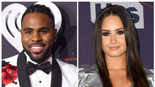 "FILE - In this combination photo, Jason Derulo, left, and Demi Lovato appear at the iHeartRadio Music Awards on March 5, 2017, in Inglewood, Calif. YouTube is launching a new music competition series for emerging artists featuring Derulo, Lovato and The Backstreet Boys. Ryan Seacrest Productions and Endemol Shine North America announced Wednesday that ""Best.Cover.Ever"" will debut on YouTube later this year."