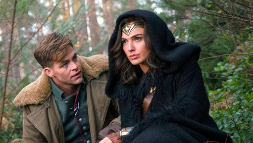 """This image released by Warner Bros. Pictures shows Chris Pine, left, and Gal Gadot in a scene from, """"Wonder Woman."""" The film, directed by Patty Jenkins, opens June 2."""