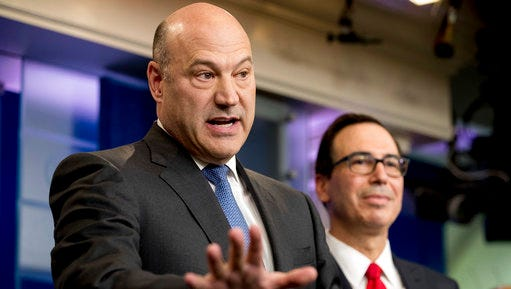 National Economic Director Gary Cohn, left, accompanied by Treasury Secretary Steve Mnuchin, speaks in the briefing room of the White House, in Washington, Wednesday, April 26, 2017, where they discussed President Donald Trump tax proposals.