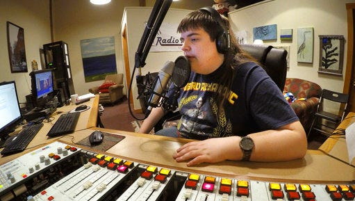 In this March 18, 2017 photo, Chaz Wing records the weather forecast at a radio station in Brunswick, Maine. Wing has testified that he was raped by other kids three times in junior high, even after repeatedly complaining of harassment to teachers and administrators. Chaz's saga is more than a tale of escalating bullying. Across the U.S., thousands of students have been sexually assaulted, by other students, in high schools, junior highs and even elementary schools _ a hidden horror educators have long been warned not to ignore.