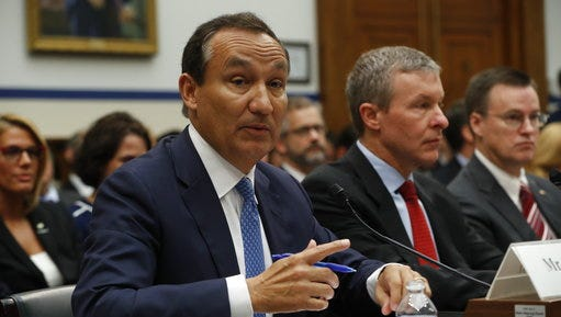 United Airlines CEO Oscar Munoz, left, accompanied by United Airlines President Scott Kirby, testifies on Capitol Hill in Washington, Tuesday, May 2, 2017, to testify before a House Transportation Committee oversight hearing.