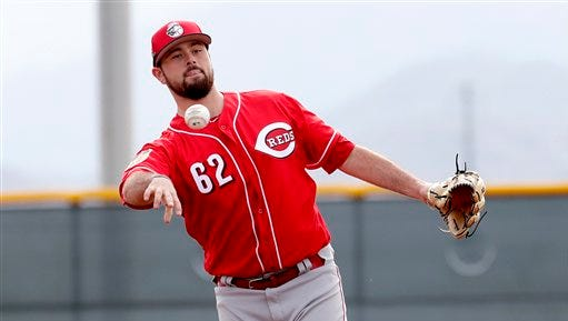 Cincinnati Reds' Jackson Stephens (62) fields a ball during the teams' first day of spring training baseball workouts, Tuesday, Feb. 14, 2017 in Goodyear, Ariz.  (AP Photo/Matt York)