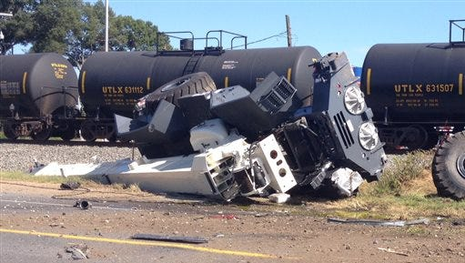 This photo shows a train derailment, Sunday in Mer Rouge, La. Two train engineers were in serious condition Sunday after their freight train hit a transport truck in northeast Louisiana, derailing two engines and 16 tank and hopper cars.