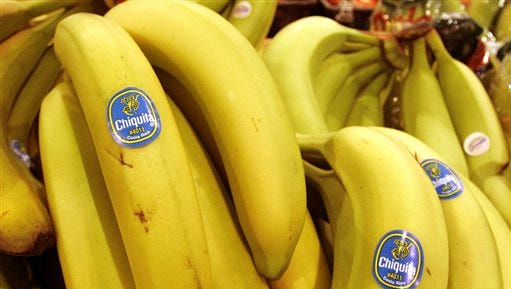 FILE - In this Aug. 3, 2005 file photo, Chiquita bananas are on display at a grocery store in Bainbridge, Ohio. Changes to the proposed merger agreement between Chiquita and the Irish fruit company Fyffes will give Chiquita shareholders a larger stake in what would become the world's largest banana supplier. Chiquita and the Irish fruit company Fyffes said Friday Sept. 26, 2014 that shareholders of Chiquita Brands International Inc., under the revised deal, will hold nearly a 60 percent stake, up from about 51 percent. (AP Photo/Amy Sancetta, File)