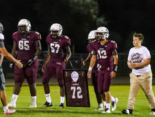 A ceremony honoring Zach Martin Polsenberg was held before the 2017 game between Palmetto Ridge and Riverdale. His family walked with his teammates as they carried Zach's jersey.