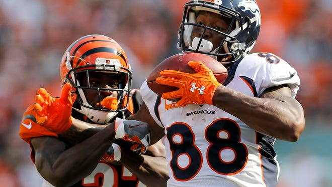 Denver Broncos wide receiver Demaryius Thomas (88) catches a pass for a touchdown ahead of Cincinnati Bengals cornerback Chris Lewis-Harris (37) in the fourth quarter of the NFL Week 3 game between the Cincinnati Bengals and the Denver Broncos at Paul Brown Stadium on Sunday, Sept. 25, 2016. The Bengals fell to 1-2 with a 29-17 loss.