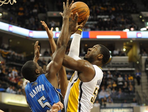 Indiana's Roy Hibbert drives against Orlando's Victor Oladipo in second quarter action as the Indiana Pacers hosted the Orlando Magic at Bankers Life Fieldhouse Monday February 3, 2013.