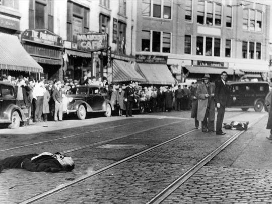 The scene on Central Street in Bangor, Main shows the bodies of Al Brady and his henchman, Clarence Shaffer after they had been shot to death in a gun-battle with FBI agents and Indiana State Police.