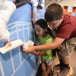 Jocelyn Mendoza and Jair Solano, right, check out an exhibit at the Museum of Discovery. They attend The Family Center nonprofit child-care center, which received a $30,000 Pharos Fund grant this spring.