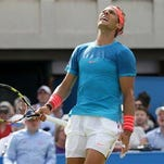 Spains Rafael Nadal looks up after losing a point to Ukraines Alexandr Dolgopolov during their men's singles tennis match at Queen's tennis championship in London, Tuesday.