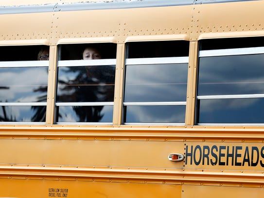 Children peer from inside a Horseheads school bus,