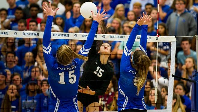 Gulf Coast High School senior Emily Damon spikes against Barron Collier High School at Barron Collier High School on Tuesday, August 29, 2017.