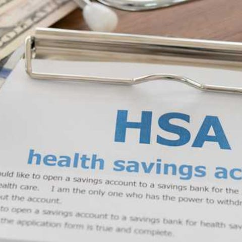 HSA paperwork with money on top.