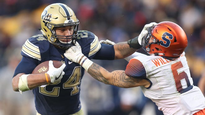 Pittsburgh Panthers running back James Conner (24) stiff arms Syracuse Orange defensive back Rodney Williams (6) on a carry during the fourth quarter at Heinz Field.