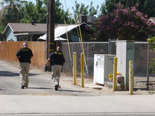 Tulare Evidence Technicians Gary Coffman, left, and