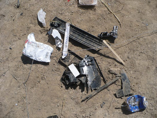 Debris from a drunken crash that killed a child and