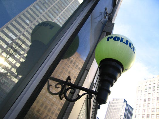 A police lamp outside a police station in downtown