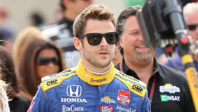 Indy Car driver Marco Andretti makes his way to the track during the 99th running of the Indianapolis 500 Sunday May 24, 2015.