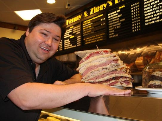 Ziggy Gruber, a third-generation deli owner, shows