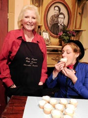 Jackie Kennedy, left, so loves Mary Poppins that she and her husband named their Woodville business after the character. Actress Samantha Trapp of Clyde, who will perform as Mary Poppins, tastes one of Kennedy's special cupcakes that will be on sale during intermission.
