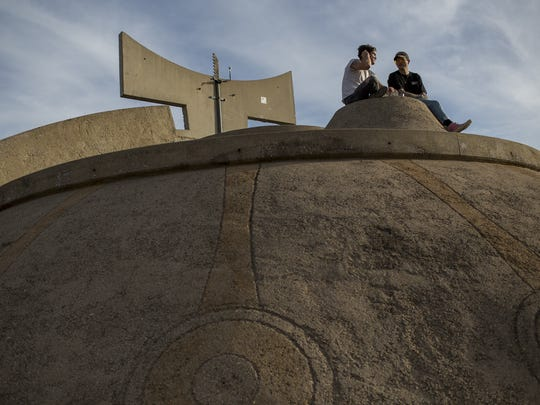James Kristofik (left) and Bryan Sammis sit on a dome at the FORM Arcosanti festival on May 12, 2017.