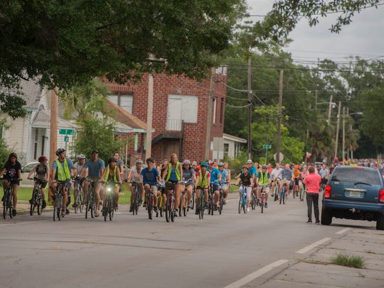 Bikers enjoy the Slow Ride on July 7. The monthly event returns on Friday.