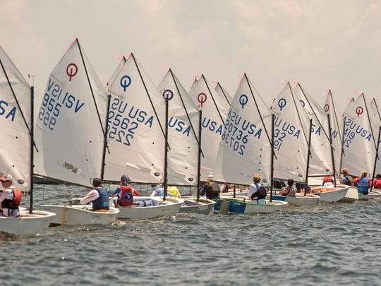 Sailors make their way around the course Sunday, July 15, 2018 during the USA Optimist National Championship hosted by Pensacola Yacht Club.