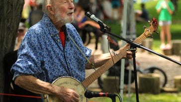 Pete Seeger performs with the Rivertown Kids as Beacon Sloop Club holds its annual Strawberry Festival Sunday, June 10, 2012, in Beacon.
