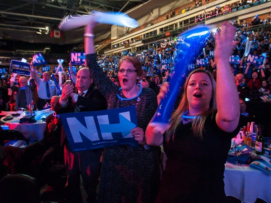 Supporters of Democratic presidential candidate Hillary Clinton cheer as she speaks at the New Hampshire Democratic Party's 2016 McIntyre-Shaheen 100 Club Celebration at the Verizon Wireless Center in Manchester on Friday, February 5, 2016.