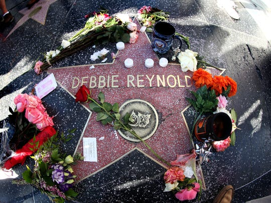 Mementos are placed on the star of the late actress