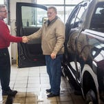 A customer picks up his truck from the service center at Toyota of Muncie Tuesday.