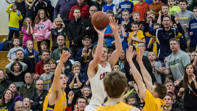 Laser fans gasp in disbelief as Hamilton's Brady Ellingson fires off a game winning three point buzzer-beater to upset Kettle Moraine 49-46 in the WIAA Division 1 regional final on Saturday, March 1, 2014.