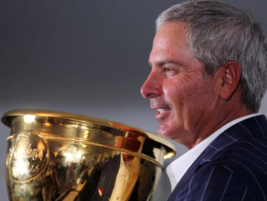 Fred Couples poses with the Presidents Cup trophy.