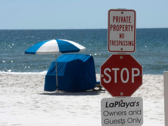 No trespassing signs line Perdido Key on Tuesday, April