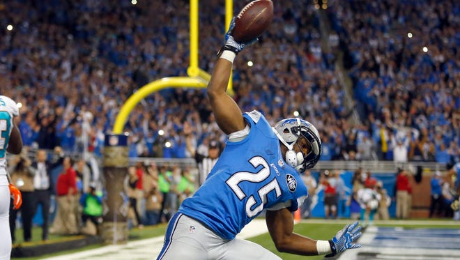 Detroit Lions running back Theo Riddick celebrates his game-winning touchdown against the Miami Dolphins on Nov. 9, 2014, in Detroit.