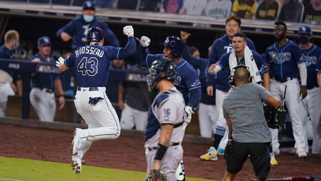 Tampa Bay Rays' Michael Brosseau (43) celebrates after hitting a solo home run during the eighth inning in Game 5 of the baseball team's AL Division Series against the New York Yankees, Friday, Oct. 9, 2020, in San Diego.