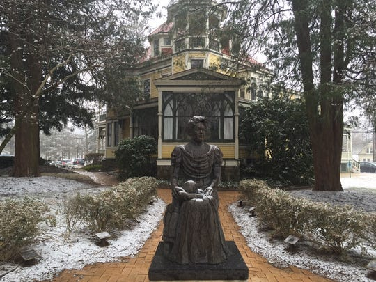 A statue of Margaret Bancroft, who in 1883 founded a nonprofit that serves people with developmental disabilities, stands outside Lullworth Hall in a file photo. The statue is now at Bancroft's Mount Laurel campus.