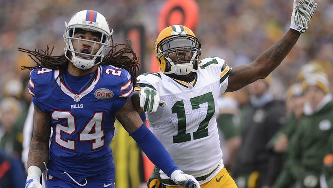 Green Bay Packers receiver Davante Adams (17) and Buffalo Bills cornerback Stephon Gilmore (24) battle for a pass in the second quarter during Sunday's game at Ralph Wilson Stadium in Orchard Park, N.Y.