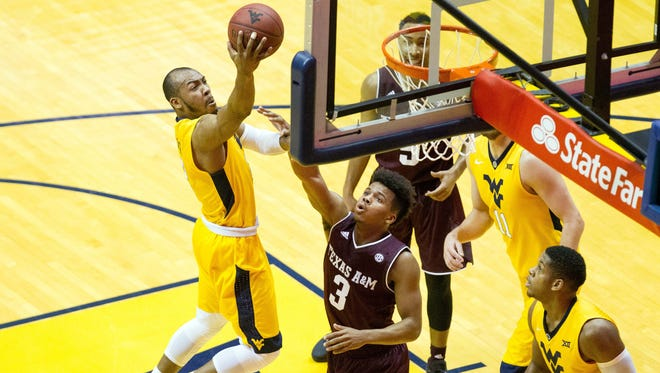 West Virginia  guard Jevon Carter drives to the basket during the first half against Texas A&M.